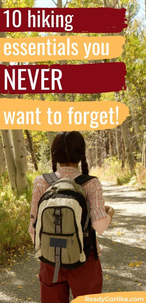 Woman hiking in forest text overlay 10 Hiking Essentials You Never Want to Forget