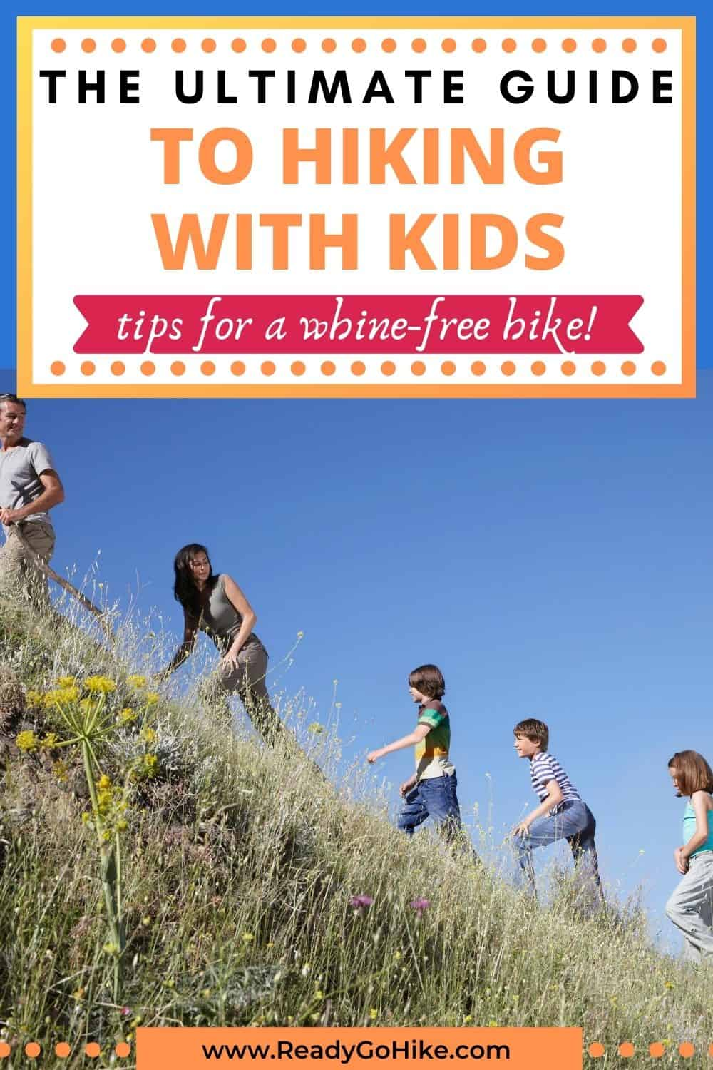 Family hiking up hill with text overlay The Ultimate Guide to Hiking With Kids