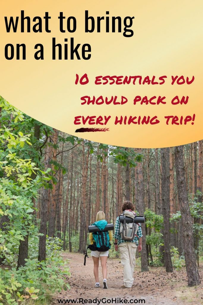 Couple hiking in forest text overlay What to Bring on a Hike