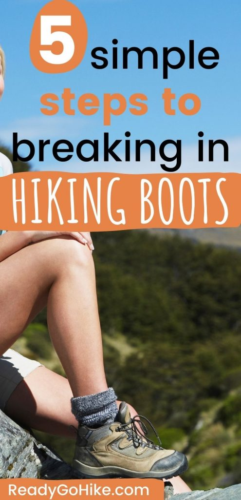 Woman sitting on rock overlooking mountains with text overlay 5 Simple Steps to Breaking in Hiking Boots