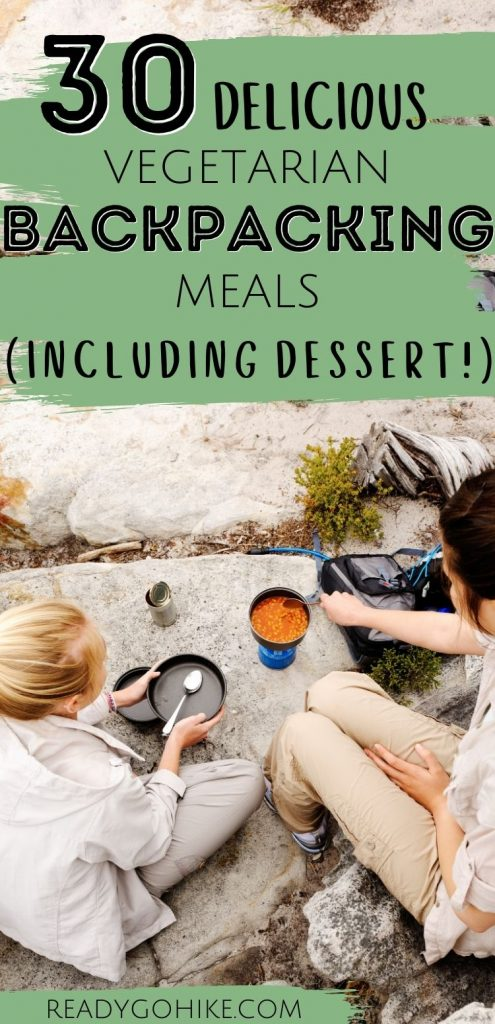 Female hikers cooking camping meal with text overlay 30 Delicious Vegetarian Backpacking Meals