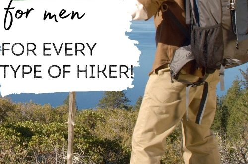 Male hiker standing on edge of trail overlooking ocean with text overlay 10 Best Hiking Pants for Men