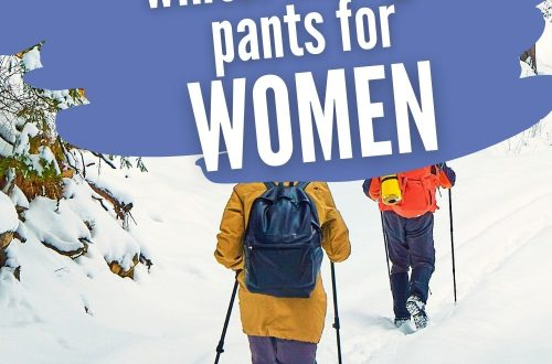 Picture of hikers walking on snowy trail with text overlay 10 Outstanding Winter Hiking Pants for Women