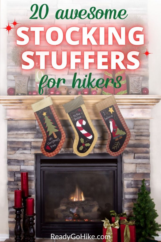 Picture of stockings hanging in front of stone fireplace with text overlay 20 Awesome Stocking Stuffers for Hikers
