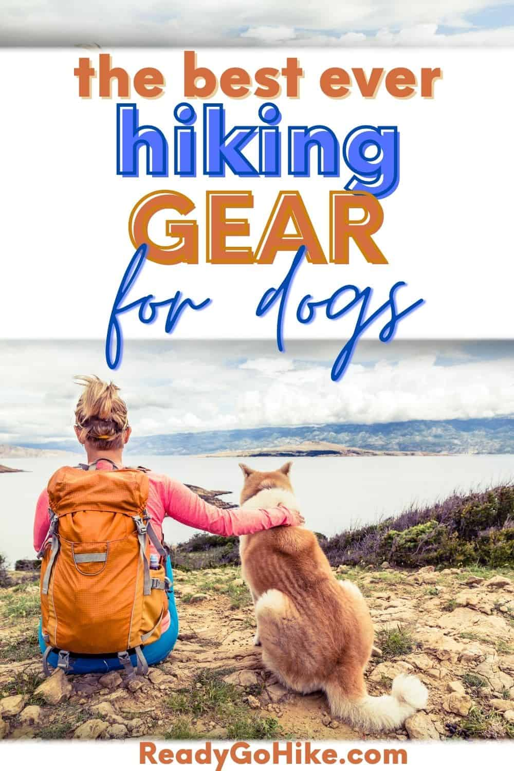 Picture of hiker with dog looking at sea with text overlay The Best Ever Hiking Gear for Dogs