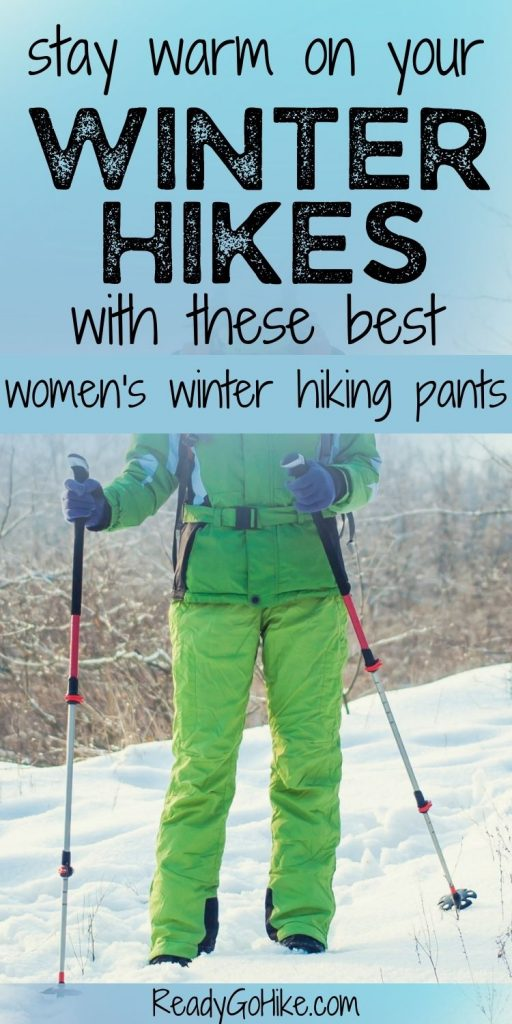 Female hiker walking through snowy forest with text overlay Stay Warm on Your Winter Hikes With These Best Women's Winter Hiking Pants